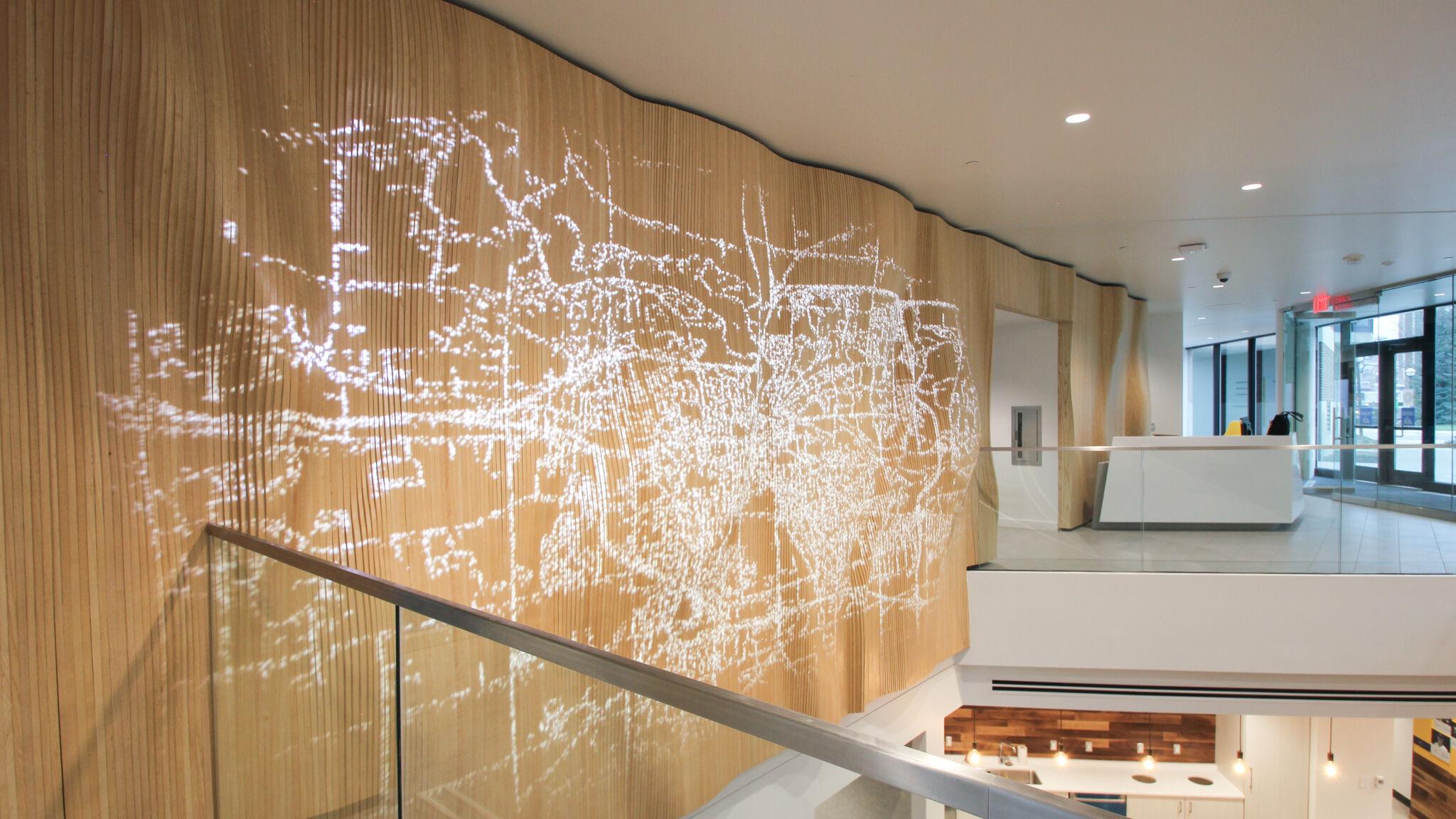Data visualization on feature wall at the University of Michigan Alumni Center